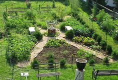 The notion of a potager is the addition of decorative pathways and a creative plan. Two diagonal intersecting gravel paths and circle in the center, create an X-shape that yields four main planting areas. Within the central stone-bordered rondel is a vertical feature, square brick pedestal topped by a planted urn. Space around the pedestal base allows for additional greenery and a pair of curved benches. - cokuke via Atticmag