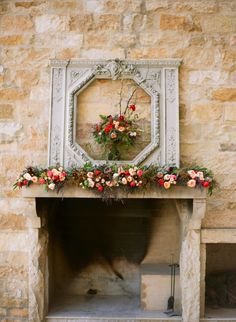 Bloom covered fireplace | Photography: Diana Marie Photography - dianamarieblog.com | Bouquet: Holly Chapple - hollychappleflowers.com | Tablescape Design: Nancy Liu Chin Designs - nancyliuchin.com  Read More: http://www.stylemepretty.com/little-black-book-blog/2014/05/23/rustic-farm-tablescape-wedding-inspiration-chapel-designers-workshop/