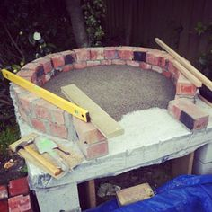 Not really a fire pit but how to make a pizza oven....great pics of how to