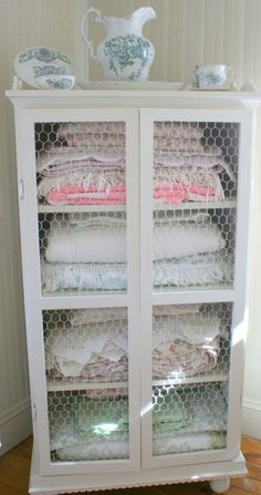 Love the chicken wire on this cabinet.