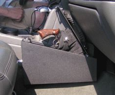 QuickDraw Gun Safe for Cars and Trucks The QuickDraw gun safe from TruckVault allows for very easy access to guns from the front seat of a car or truck. Weapon Storage, Gun Storage, Hidden Gun, Hidden Safe, Safe Vault, Cool Guns, Truck Accessories, Guns And Ammo, Concealed Carry