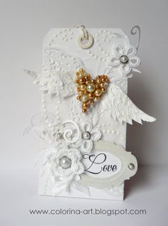 pearl covered heart, tatted flowers, textured wings