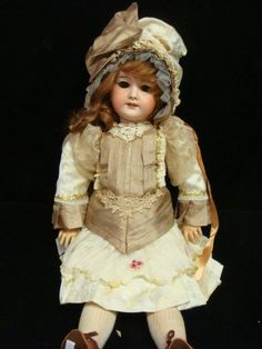 "SFBJ 301 French Bisque Socket Head Doll: Dollyface Marked SFBJ 301 Paris, 11. Feather Brows, Brown Sleep Eyes with Mohair Lashes. Pierced Ears, 6 Teeth Set in Open Mouth and Chin Dimple. Open Pate, Replaced Wig, No Repairs to Head, No Chips to Hands. 25""T. This Mark is an Umbrella for Several Makers, Society Franchaise de Fabrication, 1899-1958. (1000-1800)"