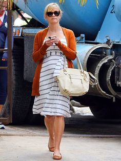 84ad74712a572 Expectant mom Reese Witherspoon earns her stripes in a Rosie Pope dress  after checking up on the construction of her new home Wednesday in Bel Air