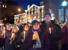 People attend a vigil for victims of a shooting at a mosque in Quebec City on Sunday, at the Grand Parade in Halifax on Monday, Jan. 30, 2017. Multiple people died in the attack which occurred during evening prayers. (Andrew Vaughan/The Canadian Press via AP)