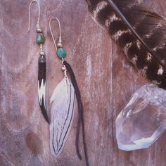 gypsy child. asymmetrical feather and bone earrings by SpiritTribe