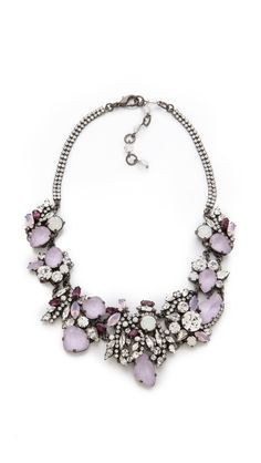 Erickson Beamon Pretty in Punk Crystal Collar. This statement necklace is the perfect intersection between edgy and delicate, with its chunky structure filled with delicate, milky stones. Lavender hues contrast well with gunmetal settings, and the Swarovski crystals set into the chain add an unexpected dose of sparkle.