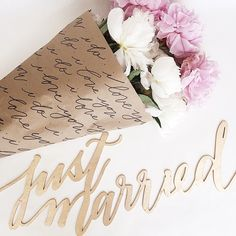 Laser cut wood and calligraphic flower wrapping by @lhcalligraphy