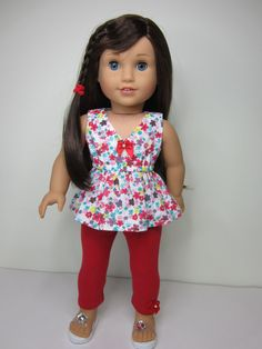 Red floral Salina Top and capris by JazzyDollDuds on Etsy. Made with the Liberty Jane Clothing Salina Dress pattern,  found here http://www.pixiefaire.com/products/salina-dress-18-doll-clothes. #pixiefaire #libertyjane #salinadress