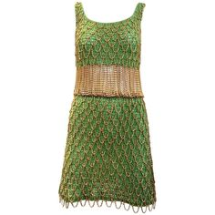 1970s Loris Azzaro gold and green knit chain dress | From a collection of rare vintage evening dresses and gowns at https://www.1stdibs.com/fashion/clothing/evening-dresses/