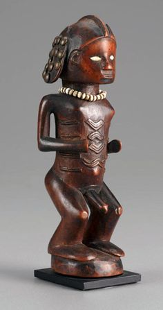 Africa | Male figure from the Bembe people of DR Congo | Wood, shell and mirroed glass