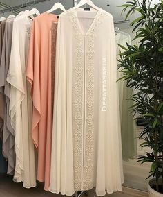 These are abaya. They look so elven, as well. Mode Abaya, Mode Hijab, Muslim Dress, Hijab Dress, Islamic Fashion, Muslim Fashion, Abaya Fashion, Fashion Dresses, Fashion Shoes