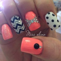 I like the bold black and white with this beautiful peachy pink color