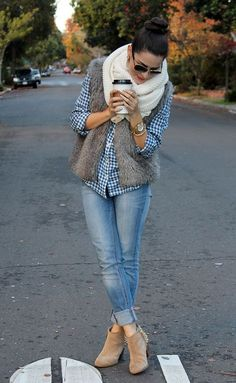 Gingham shirt with faded jeans, gray furry vest, big sweater scarf and ankle booties.