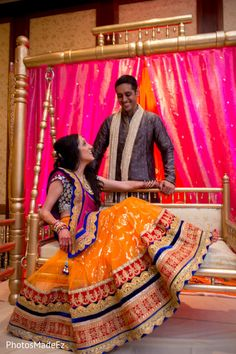 An Indian bride and her groom celebrate the beginning of their wedding festivities!