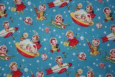 Fabric retro rocket via troispetitspois.nl