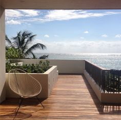 Alcapulco Chair on the Sunrise Terrace. Casa Xixim Ecoluxe Beachfront Villa at Soliman Bay, Tulum, Mexico.