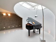 The Atticus Apartment Project: The Piano Room by Studio Damilano // Gotta need a music room!