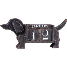 This guy is too adorable, I love that he's a calendar forever, not just one year!    Dog-shaped desk calendar with block numbers and a vintaged finish.    Product: Calendar décorConstruction Material: