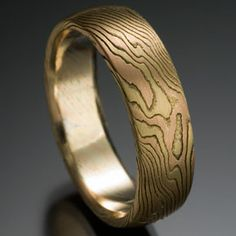 Chris Ploof - Mokume Gane Ring in the Classic Wood Grain Pattern, alternating layers of 18k yellow gold, 14k red gold, and very thin silver, rounded top, silver etched to enhance contrast. Shown in 6mm. DVVS Fine Jewelry