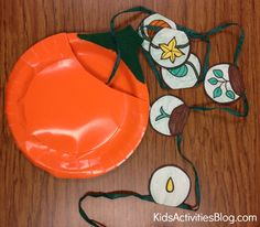An adorable science craft to demonstrate a pumpkin life cycle for kids!
