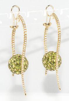 1stdibs.com   Dramatic peridot and diamond drop earring.