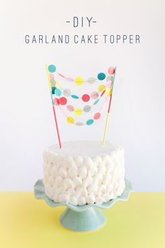 This brightly coloured multi-strand garland really makes this white cake stand out. It would look equally as striking in different pastel shades and would make the perfect decoration for weddings, birthdays and even baby showers.