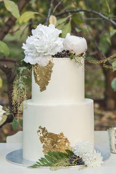 White buttercream wedding cake with gold foil, ferns and peonies | Taylor Mitchell Photography