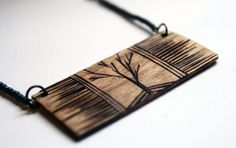 Wood burned jewelry... me likey. I really like this, a great twist on the normal long pendant you usually see ;)