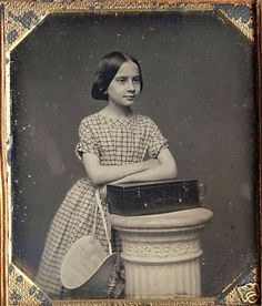 Daguerreotype of a 19th c. girl with a case and holding a bonnet