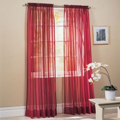 Red voile curtains. Goes with maroon paisley couch we'll have.