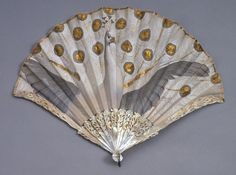 1905-1910, France - Fan painted by Adolphe Thomasse made for Duvelleroy, Paris - Silk, painted in gouache, with metal sequins; carved, incised, and gilded mother-of-pearl sticks and guards with piqué (inlaid) paste