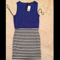 Forever 21 dress Forever 21 dress with blue upper and black and white striped bottom. New with tags. Size small  no trade ✔️bundle and save Forever 21 Dresses