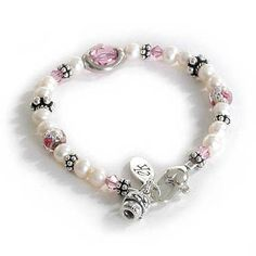 Flower Girl Bracelet As sweet and demure as the young lady wearing it, this bracelet glows with the dreamy innocence of girlhood. Pink and pretty with delicate pearls and a posy basket charm, this trinket will be a precious possession of the youngest member of the bridal party. Standard length 6 inches.