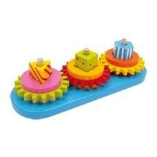 """Motor Activity Plug Game """"Gears"""": Price - £9.52 - In Stock. What a great game idea! The colourfully painted wooden elements are connected by gears. Get your first ideas of mechanisms and try to find the best combination of the wooden elements to get all wheels rotating by moving only one of them.  recommended minimum age From 3 years  Dimensions Size approx. 27 x 9,5 x 7,5 cm"""