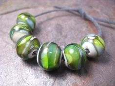 watercolor 6 itty bitty lampwork glass beads by beeboo on Etsy