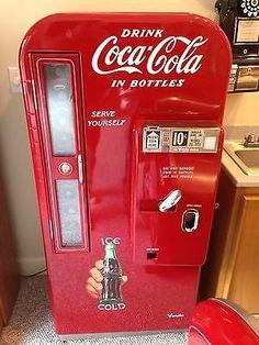 Image from http://shootmagazine.com/wildwest/img-large/vintage-1950s-vendo-81-coke-coca-cola-vending-machine-professionally-restored-nr_r058132339002.jpg.