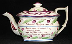 This lovely London shaped teapot is hand-painted with information about the artist. Her name, date of birth and dwelling place are on one side of the teapot and a selection from the Bible is on the other side. Although the teapot shows the date of Elizabeth Phillipson's birth, 1804, the teapot was probably decorated around 1820, perhaps for a special birthday, engagement or wedding.