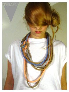 French knitting necklace. Don't like the uneven lengths, but do like the knotted focal on the side
