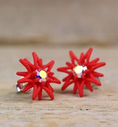 Stunning Red Star Stud with twinkling stones. The shape of the Poinsettia flower inspired me to this design; I like the shape of their blossoms.