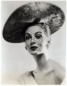 """Carmen is wearing a hat called 'The way you look tonight' from milliner Mr. John's """"Lucky in Love"""" collection for fall and winter, 1953"""
