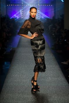 Collection printemps-été 2013.  Model Joan Smalls channelling her inner Sade on the runway.  www.jeanpaulgaultier.com #JPGaultier #PFW