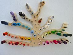 What a great way to organize thread and use it as a piece of art all at once! I can totally make something like this.