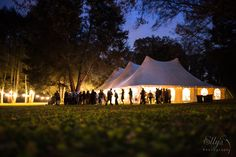 Gorgeous evening wedding reception under our 50x80 wide high peak tent www.bigskyrents.com