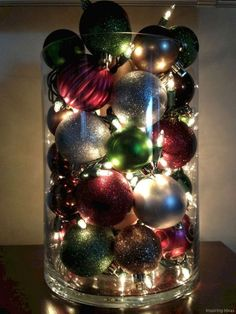 """Pinner wrote: Made by putting ornaments and Christmas lights inside a large vase with a cardboard tube in the center as a filler. Even though Christmas lights """"burn cool"""", I still suggest this only be turned on when you're home. Christmas Decorations For The Home, Christmas Centerpieces, Xmas Decorations, Christmas Projects, Holiday Crafts, Christmas Ideas, Diy Decoration, Homemade Christmas, Holiday Ideas"""