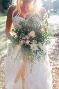 Wild bouquet with ranunculus and pepper berry #cedarwoodweddings Trending :: Wildly Romantic Bridal Bouquets | Cedarwood Weddings