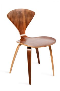 """Utilizing the ultimate symbol of mid-century modernism, the Plycraft Chair uses molded plywood to achieve striking curves, a slim profile, and a big statement.  Weight limit: 300 pounds dimensions: 31.5 inches high x 18 inches wide x 17 inches long, seat height: 18"""", seat back is 14"""" high"""