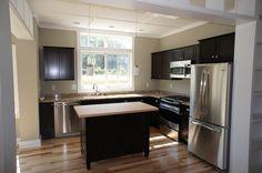 Kitchen.  For more photos of Ross Chapin's Plumrose cottage visit:  http://www.inglenookcarmel.com/homes/plumrose/
