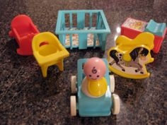 I just LOVED my Fisher Price Little People house and all the furniture and remember the little bell and the garage door???  Ahhhh...good times :)