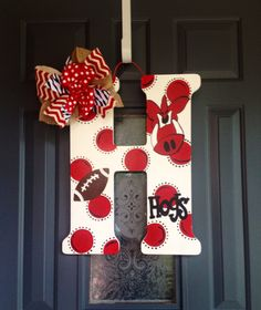 Hand painted wooden initial door hanger razorback design. Measures 18 inches tall